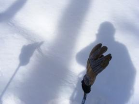 Study of glove on ski pole; self portrait - shadow on snow