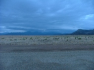 Dawn approaches on a cloudy day out on the prairie just east of the Rocky Mountains and Cimarron, NM