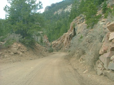 The Old Stage Road leads to Gold Camp Road, or Teller County Road 8. Regardless of the name, Gold Camp Road is built on the the bed of the old Colorado Springs and Cripple Creek District Railroad. Here is one of the narrow road cuts more commonly found in railroad construction found in mountainous country