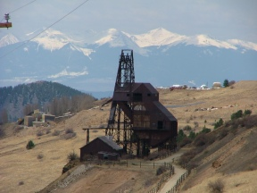 Bold view of mining remains above Victor, Sangre de Cristo Mountains looming