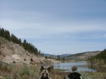 Sheba and Lucky Dog just make the scene. Needle Creek Reservoir behind them