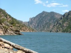 Driftwood and the wall of the Black Canyon of the Gunnison frame the waters of Morrow Point Reservoir
