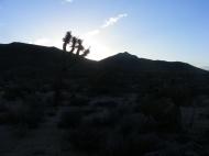 Sun rising behind distant ridge