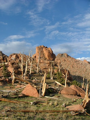 The late sun brightens up the granite-like rock of the Tarryall Mountains