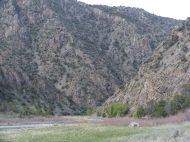 The gorge's steep slopes descend right to water's edge upstream from the park I camped in