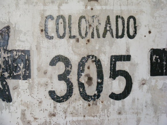 """Upon close inspection, the old border around """"COLORADO 305"""" is visible."""