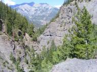 Looking back at a carved-out section of the Bear Creek Trail