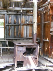 Old stove in the dilapidated boarding house at the Forks of Bear Creek