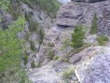 Going around this corner in view on the Bear Creek Trail is, with the rock overhanging, almost like being in a tunnel