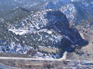 Texas Creek, the old railroad grade to Westcliffe can be seen clearly on the hillside. The roads are U.S. 50 and S.H. 69's terminus