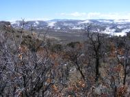 The view to the east includes Big Mesa and Sawtooth Mountain