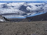 Blue Mesa Reservoir reflects a snowy mesa with unusual clarity