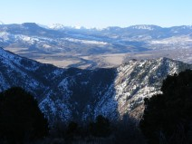 From Hermit's Rest on the north rim of the Black Canyon of the Gunnison the view encompasses the south rim, the Little Cimarron River and the San Juan Mountains