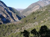 Morrow Point Dam and below, the Cimarron River descends the canyon to the left