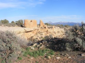Hovenweep Castle and Sleeping Ute Mountain on the horizon above Little Ruin Canyon