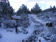 Fresh snow adorns the Three Sisters Trailhead in Lava Beds National Monument
