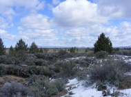 Three Sisters Trail in Lava Beds National Monument, looking east at the Clear Lake Hills, sky full of scudding clouds