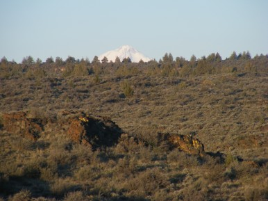 Distant snow-capped summit in the distance seen from the Fleener Chimneys in Lava Beds National Monument