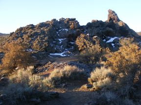 Early sun strikes one of the Fleener Chimneys in Lava Beds National Monument