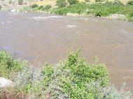 Spring melt swelling the Arkansas River near Coaldale
