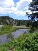 Tarryall Creek looking downstream from the Ute Creek Trailhead, the hiker's bridge in view