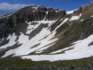 Large snowfields still extant in late June on the northeast face of Fossil Mountain above Lamphier Lake