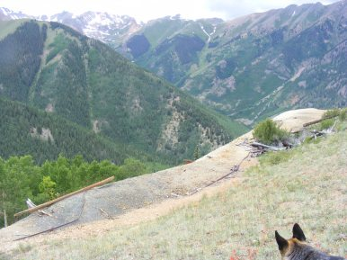 The second and higher of the two mine sites, the West Fork of Alpine Gulch in the background