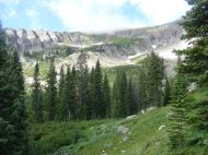 Approaching Green Lake, Mount Axtell retains a smidgen of snow in early July