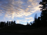 Morning sunlight striking clouds above Blacktail Deer Plateau