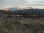 Blacktail Deer Plateau in shadow, the Gallatin Mountains alit