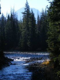 The Green River flows through the surrounding forest while the towers of granite rise above