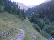 Silver Creek Trail above the creek of the same name, still in shadow below treeline