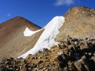 Mid-August, and a large cornice still persists on Redcloud Peak