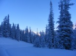 Sun's first rays atop distant peaks as I ski Old Monarch Pass