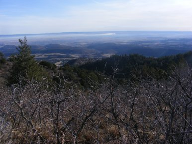 Looking down into the Arkansas River valley; the smoke is from a cement plant