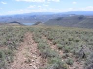 Above Dry Gulch, looking down to Blue Mesa Reservoir and off to the Powderhorn Area in the center and the San Juan Mountains to the right