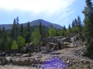 Mountains slowly reclaiming the ruins about Saint Elmo, Colorado