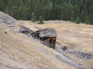 A flywheel has been disgorged from the tramhouse that served the Iron Chest Mine