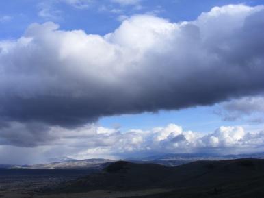 Horseshoe shaped mass of blue sky over the City of Gunnison