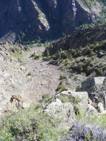 A gully of talus leading down from the Deadhorse Overlook to the Gunnison River