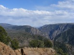 A distant view of a snow clad ridge beyond and above the Black Canyon of the Gunnison