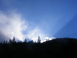The early sun streaking across a ridge above Long Branch