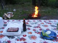 Dinner awaits as the fire burns down to usable coals on a fine evening in mid-June