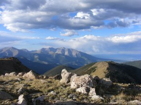 Clouds rolling over Tabeguache Peak and Mount Shavano, both of which tower above fourteen thousand feet