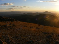 Looking out to the distant San Juan Mountains from Mount Peck at sunset