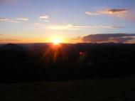 The Sun descending beyond the West Elk Mountains
