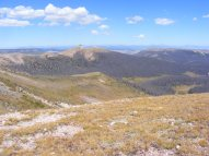Twin Peaks in the center, and beyond the West Elk and Elk Mountains, from Halfmoon Pass