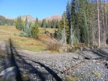 Looking up Poverty Gulch from the road crossing on Slate River; Cascade Mountain to the center left, Mineral Point to the right
