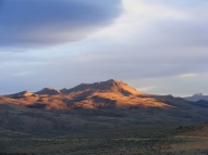 What might be Bible Back Mountain, catching the last rays of sun in Moffat County