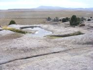 A pocket of water on the granite, looking south from the Split Rock interpretive site along U.S. 287 in Wyoming